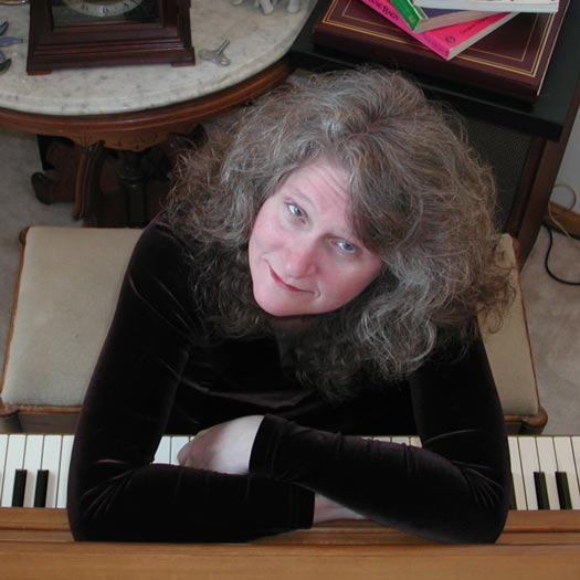 image of Sue leaning on piano